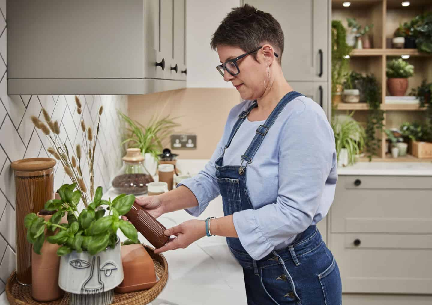 Biophilic kitchen designs provide a multi-sensory experience through natural materials and textures. Here Sblogger Stacey Sheppard arranges kitchen accessories on a marble effect worktop.