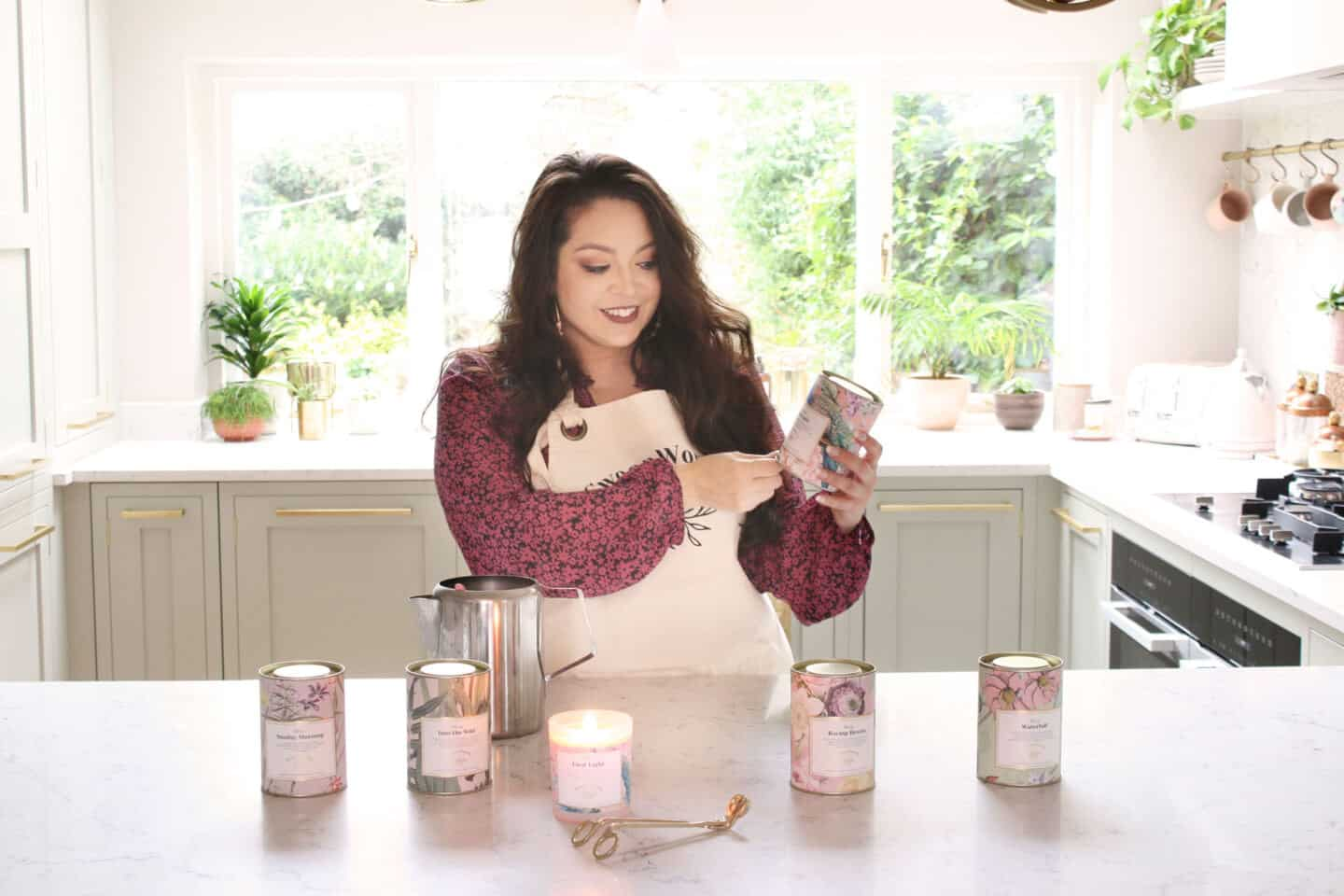 Kimberly Duran of Swoon Worthy Scents in her kitchen with her signature collection of luxury eco-conscious scented candles