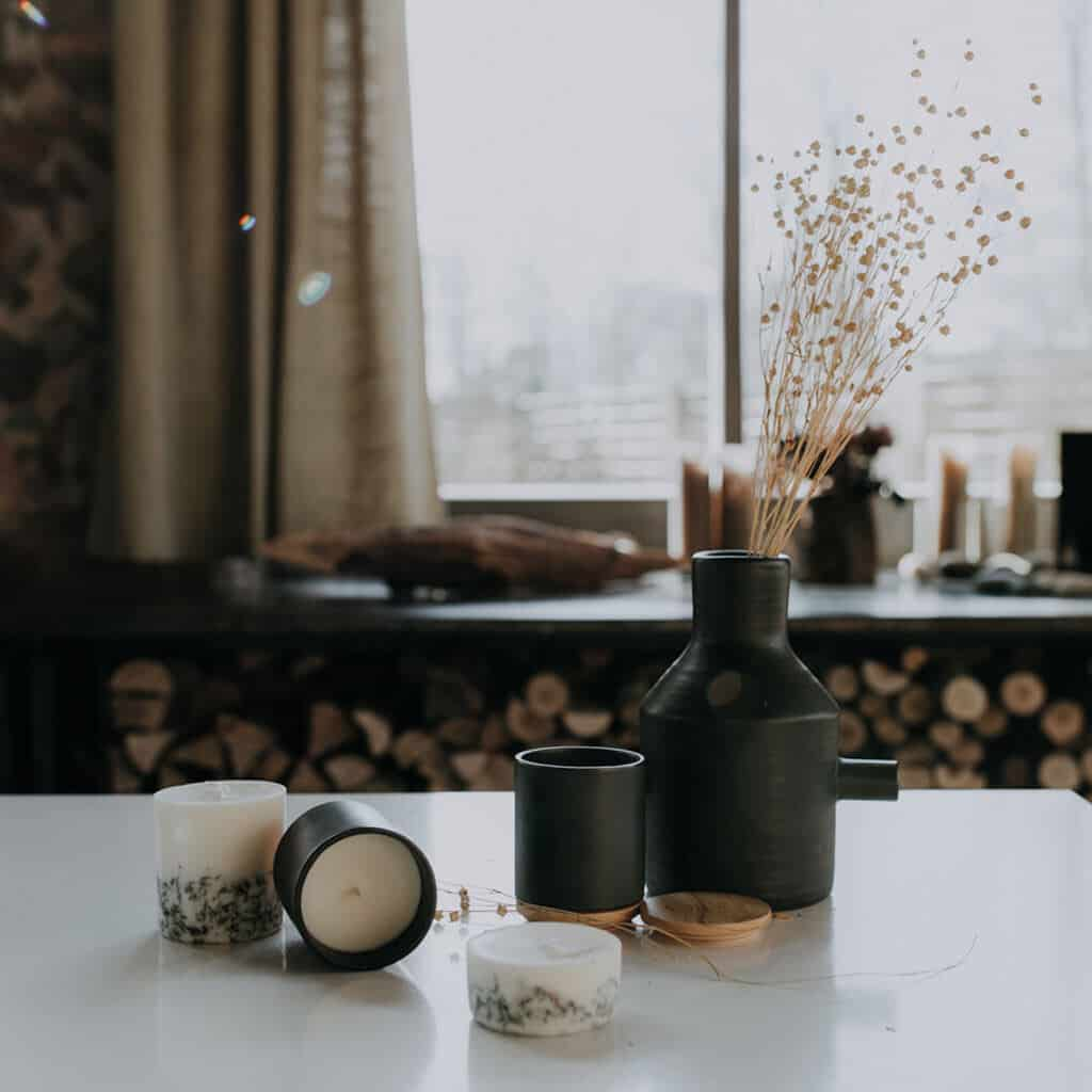 Textured Lives. Using texture in interiors to bring your home to life.  Candles on a white surface next to a vase containing dried flowers