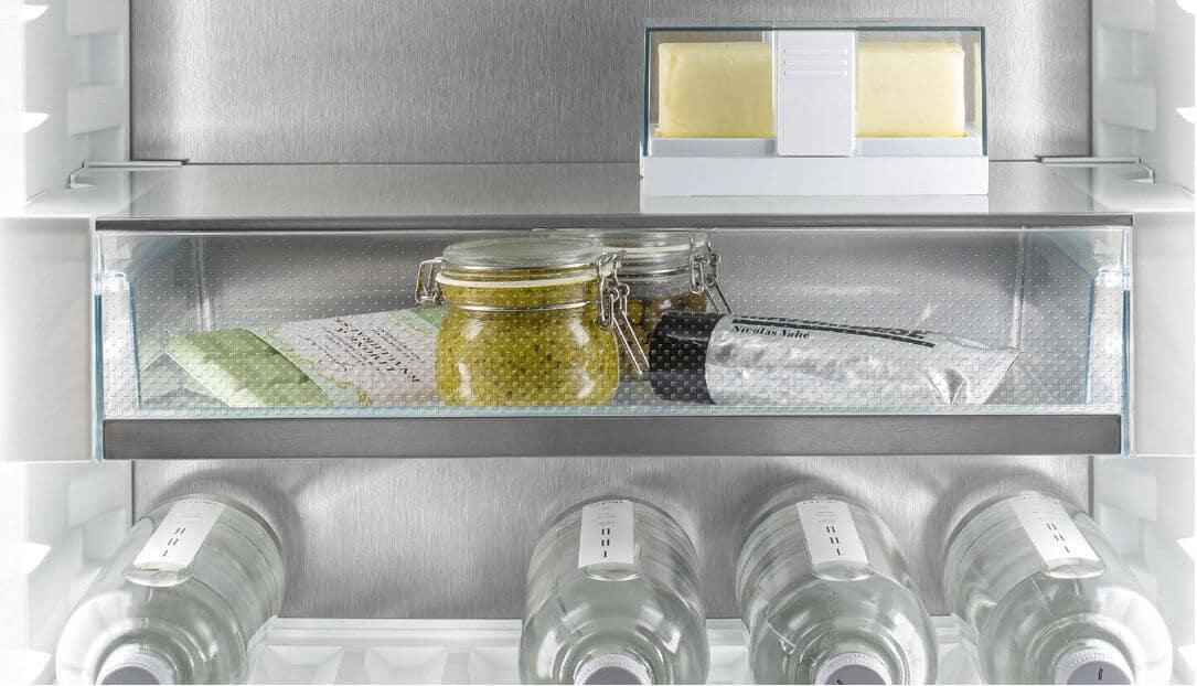 Liebherr's fully integrated appliance range. A shallow fridge drawer full of smaller food items.