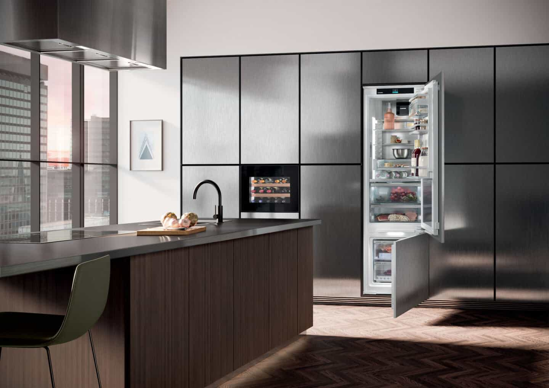 Liebherr's Fully Integrated Appliance Range. An open fridge in a modern kitchen.