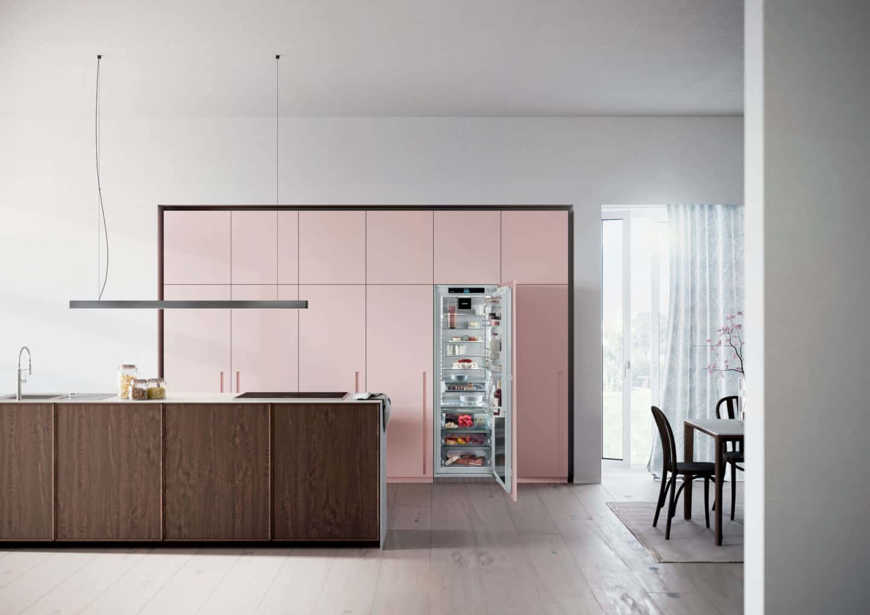 Liebherr's Fully Integrated Appliance Range. An open fridge in a pink kitchen