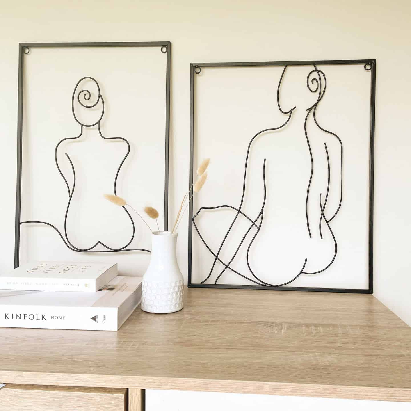 Affordable luxury homewares from Price & Coco Interiors. Two pieces of wire artwork on a sideboard leaning against the wall.