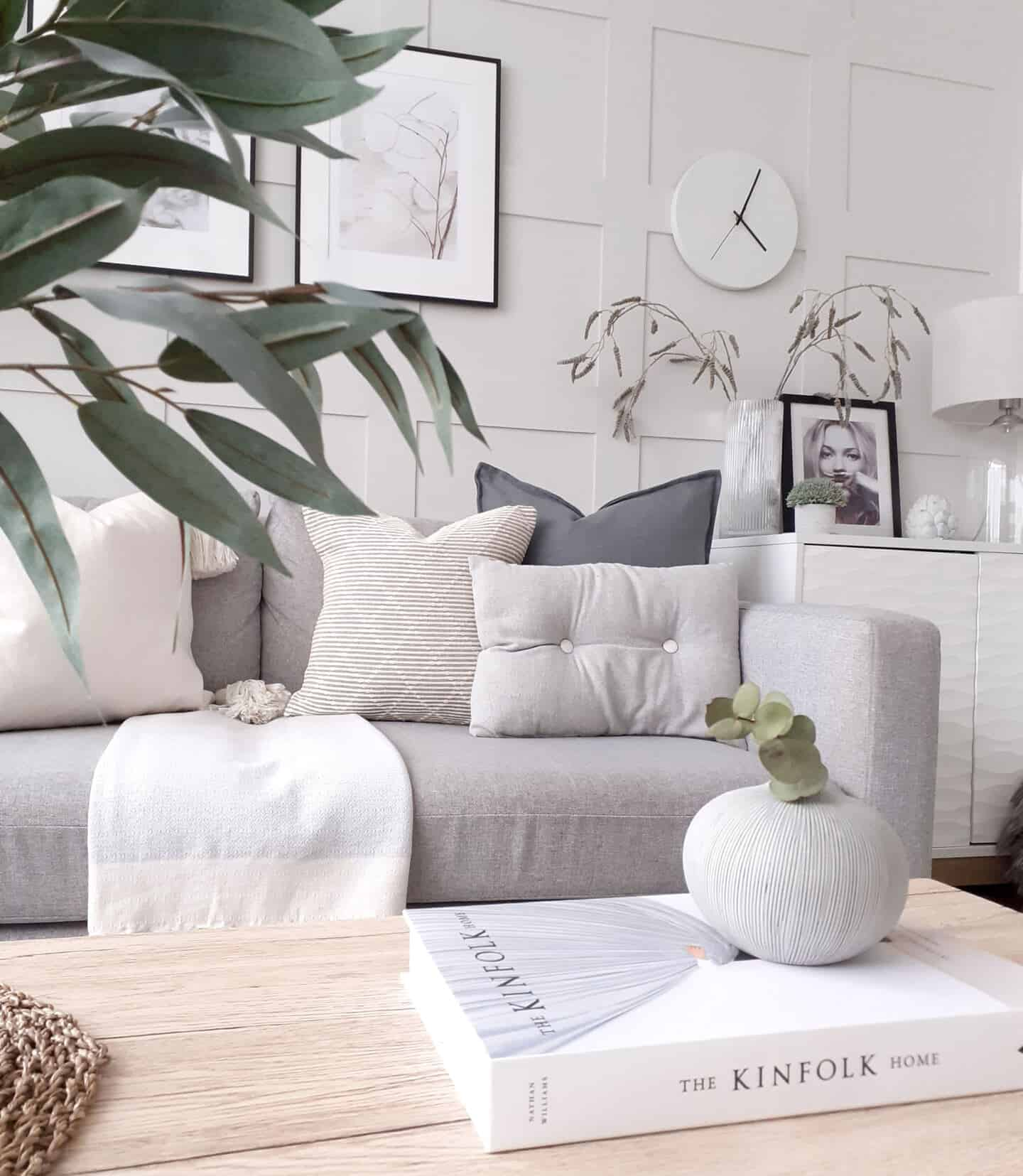 Affordable luxury homewares from Price & Coco Interiors. A small textured vase on a book on a coffee table in a monochrome Scandi living room.