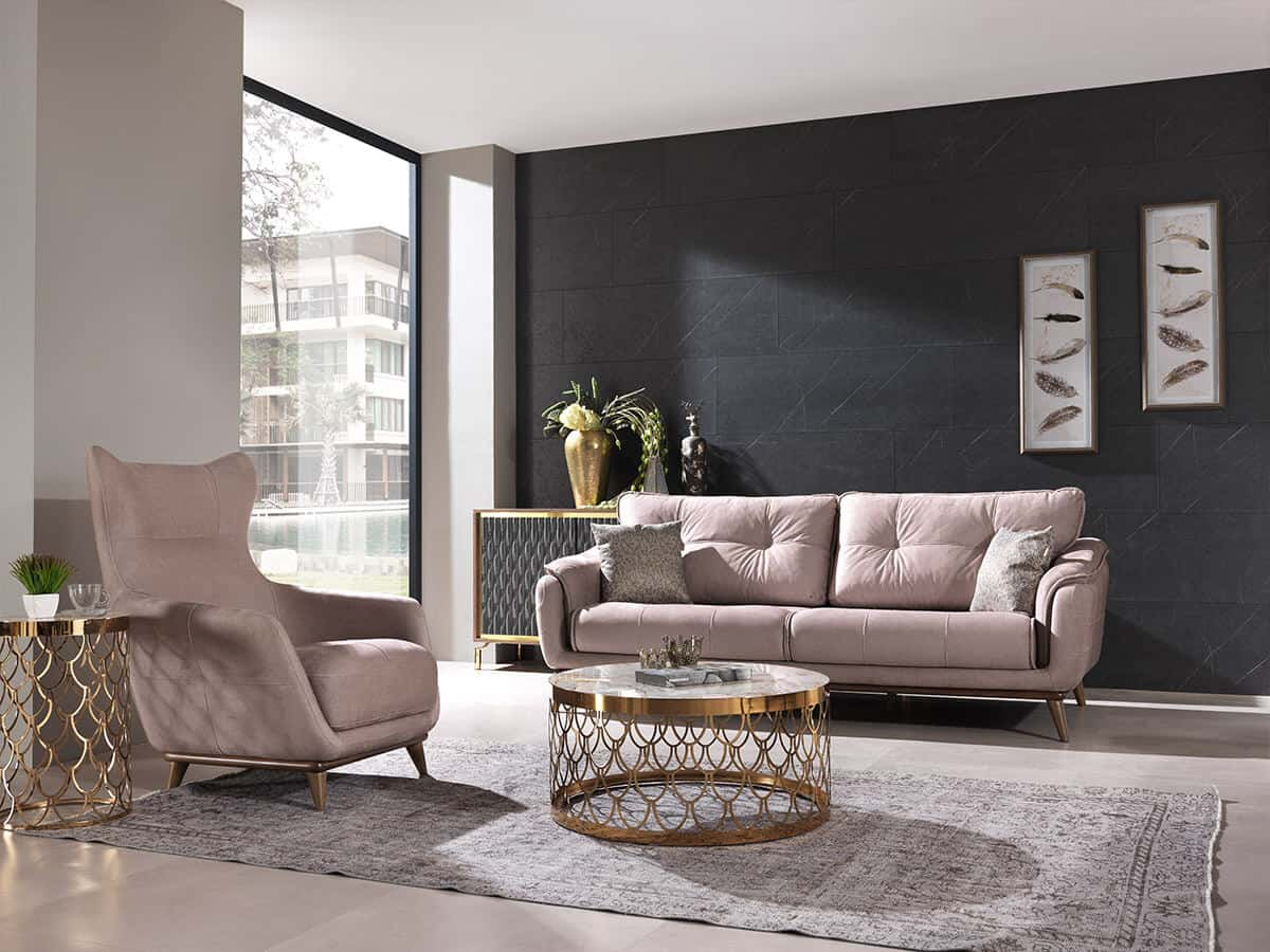 How to choose the perfect sofa for your lifestyle.  Sofa and chair arranged around a rug with coffee table on top.