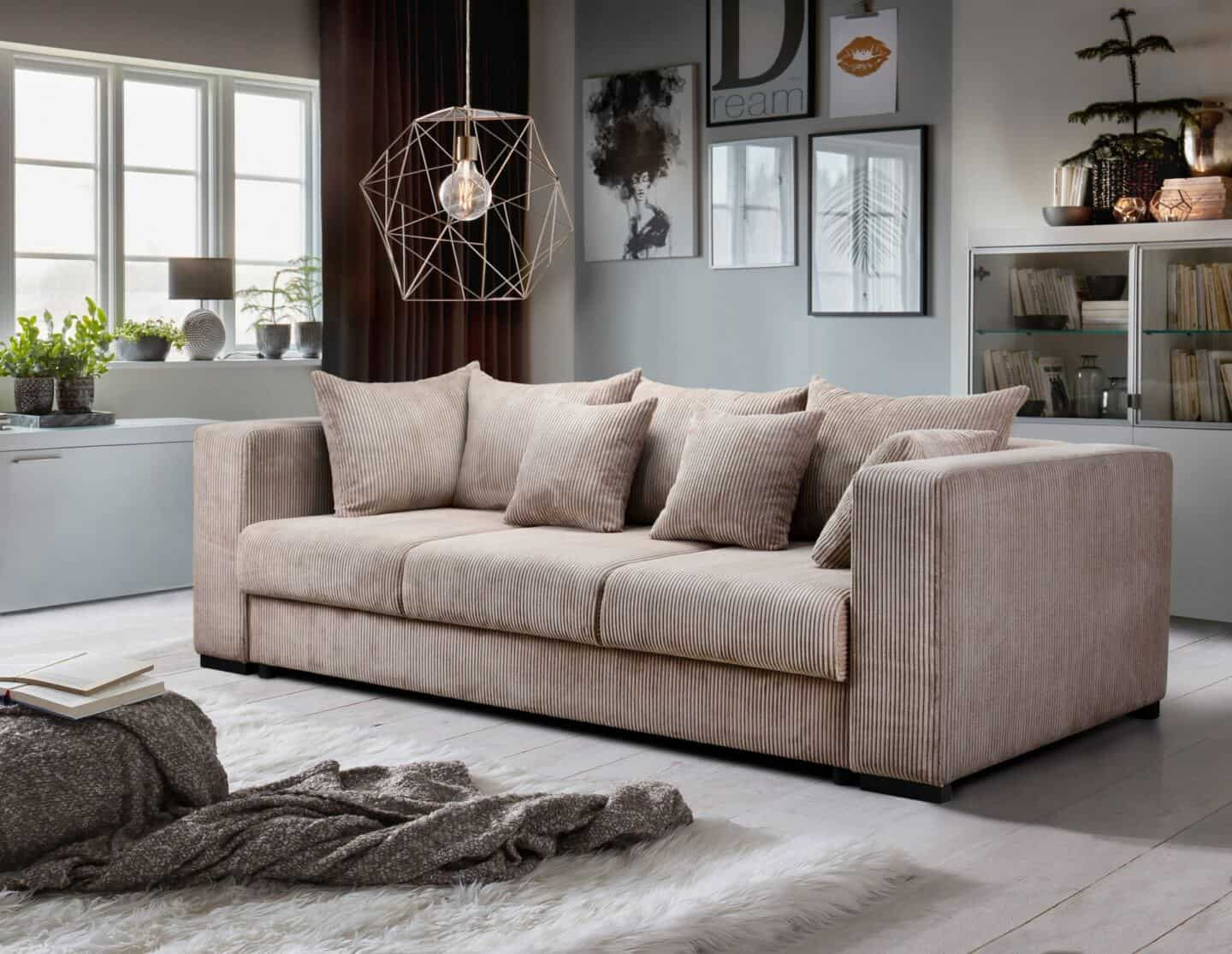 How to choose the perfect sofa for your lifestyle.  Beige Corduroy sofa in middle of room with geometric light suspended above