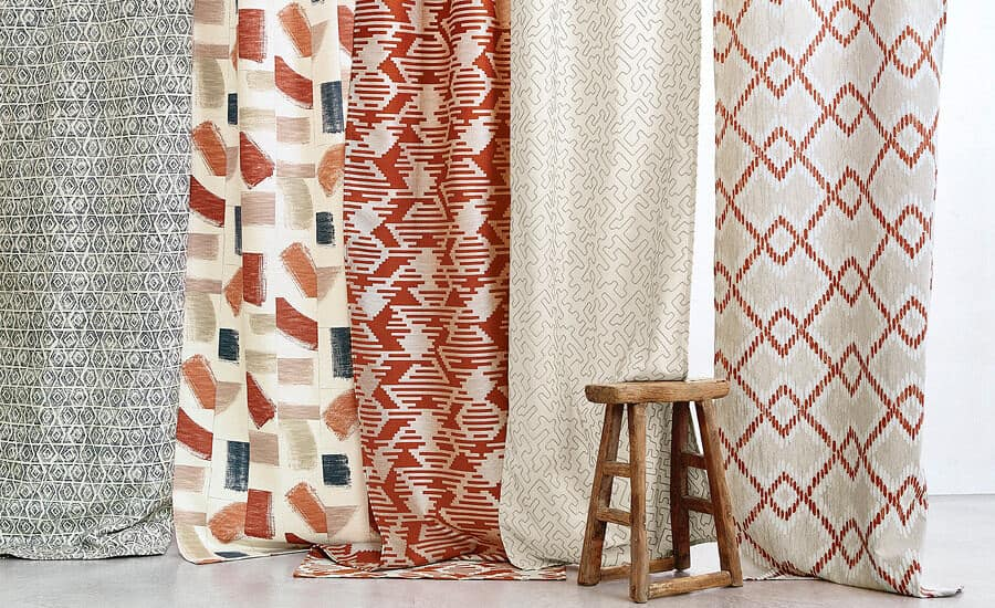 Huari fabric by Villa Nova hanging in panels with a wooden stook in front