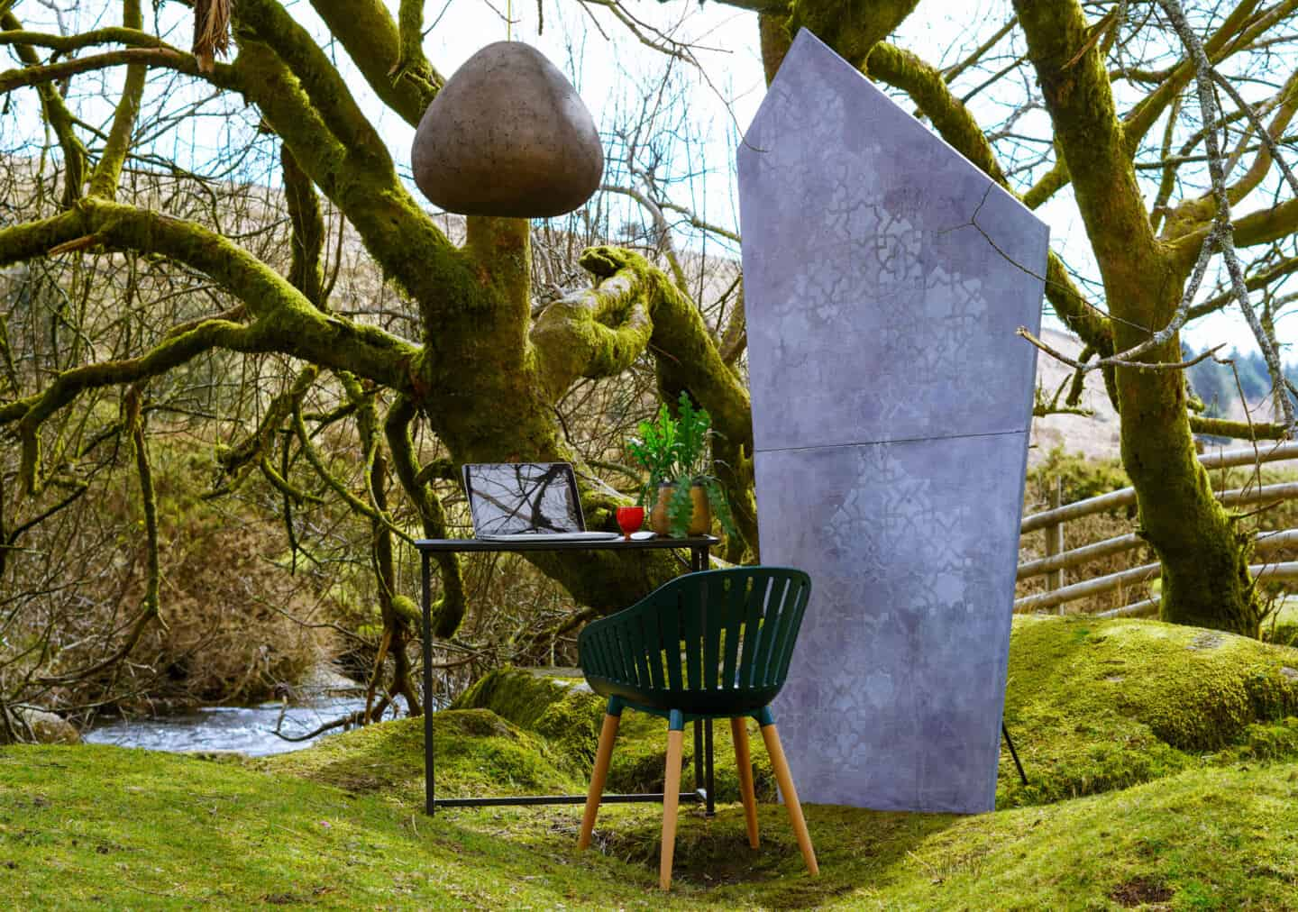 Biophilic home office inspiration. A desk and chair set up outside on Dartmoor.