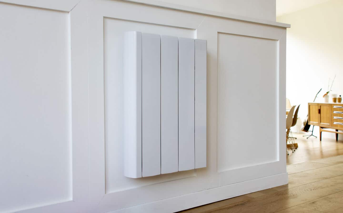 The Ecostrad iQ Ceramic radiator mounted on a white wall