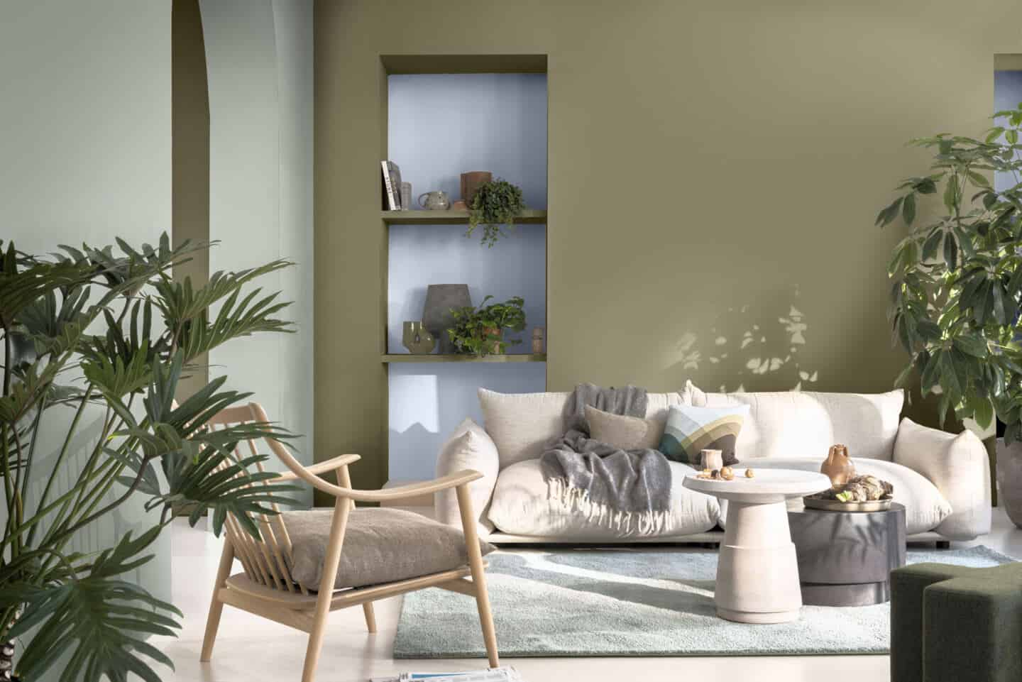 A living room with recessed shelving painted in Dulux Colour of the Year 2022 Bright Skies