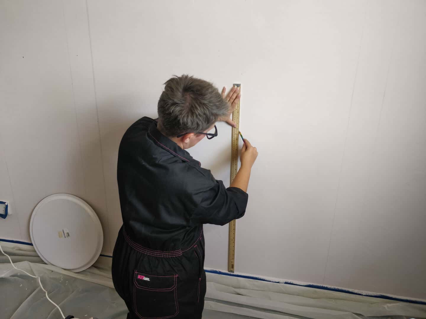 Blogger Stacey Sheppard drawing out the design for the DIY Painted Arch Accent Wall