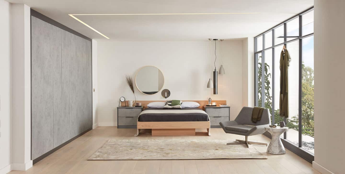 Japandi bedroom with low bed and built-in wardrobes by Sharps