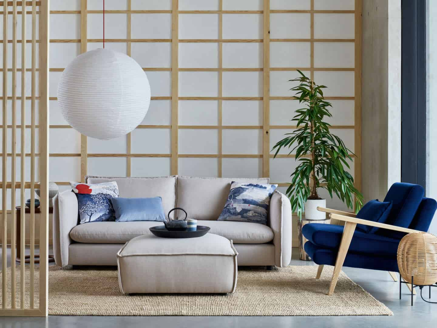 Japandi living room from DFS featuring paper screens and minimal grey sofa and pouffe